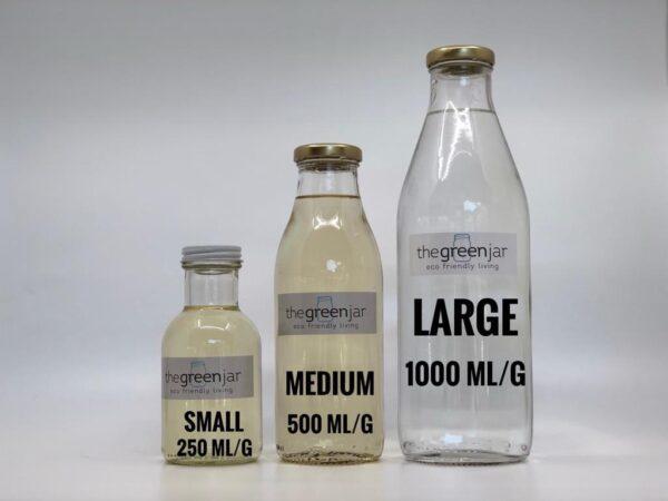 Small, medium, large bottles of liquid.